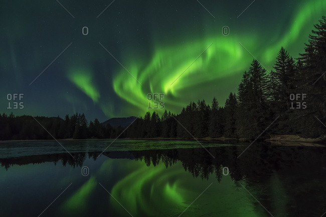 Aurora reflected in Peterson Pond, Northern Lights, Tongass National Forest; Alaska, United States of America