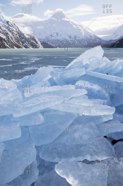 Ice breakup at Portage Lake in the Portage Valley of South-central Alaska in winter; Alaska, United States of America
