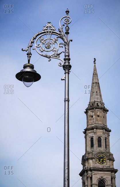 A ornate and decorative street light and clock tower; Dublin, Ireland