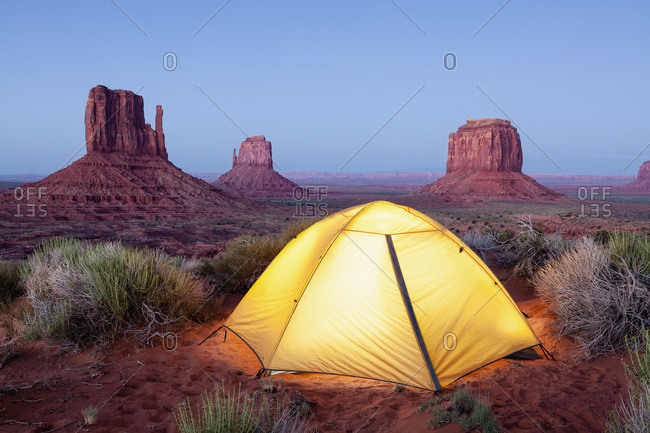 The Mittens and tent at dusk, Navajo Tribal Park, Monument Valley; Arizona, United States of America