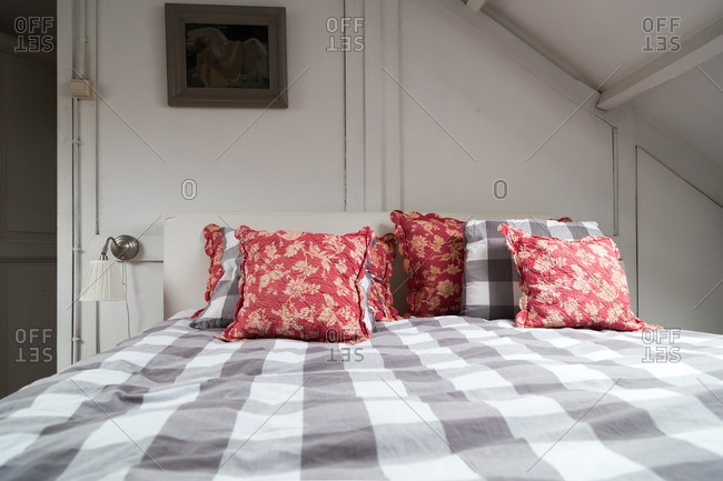 A cozy bed with checked patterns