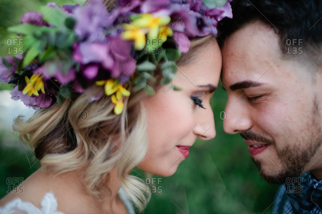 Bride with floral crown and groom