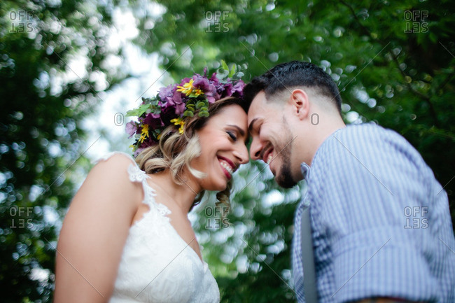Cute bride and groom with heads close