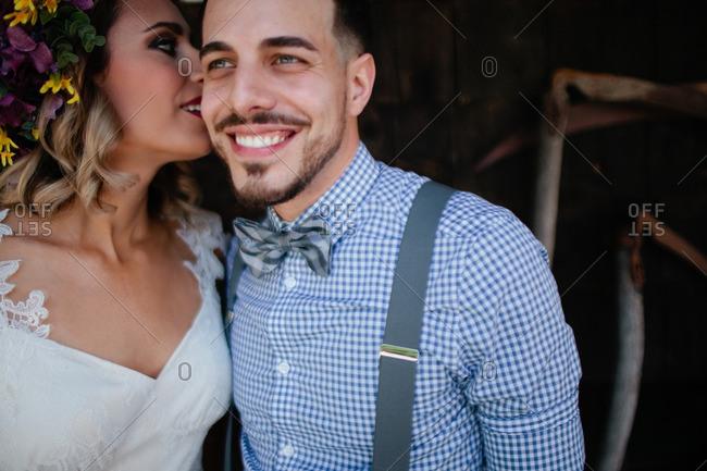 Cute bride and groom in barn setting