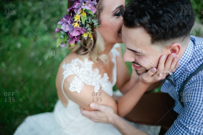 Bride talking to bride outdoors