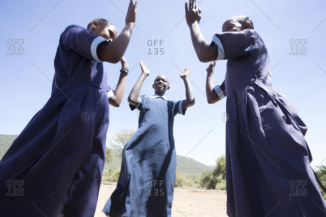 Teenage school girls playing outdoors, Kenya.