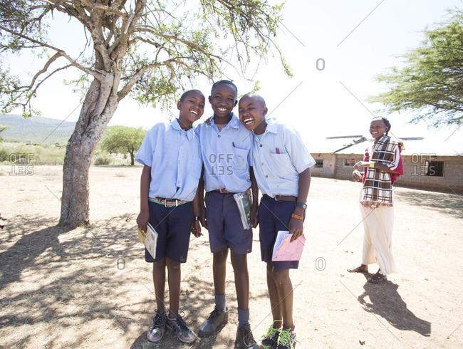 January 22, 2017 - Kenya, Africa: Smiling school boys with female teacher outdoors