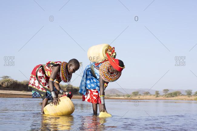 Samburu women collecting water from river in Kenya, Africa
