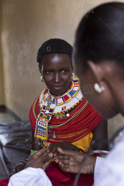 Doctor working with Samburu woman patient, Kenya