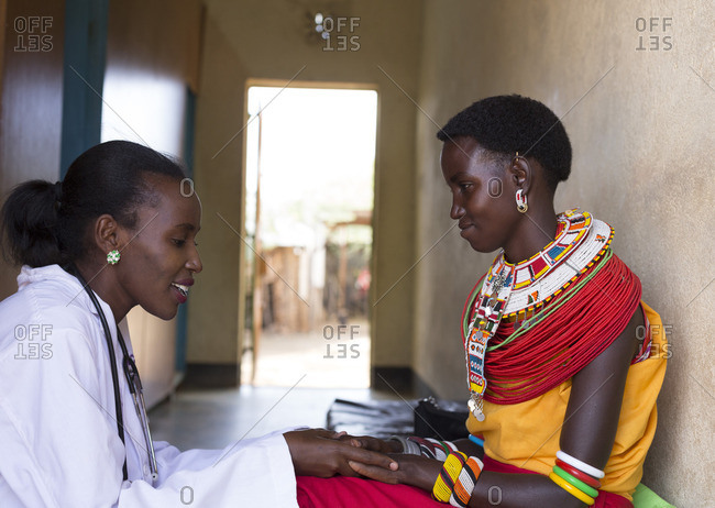 Doctor developing rapport with her Samburu patient at clinic in Africa