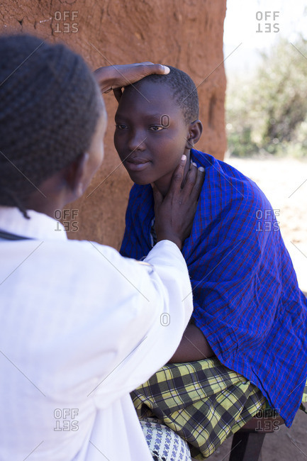 Doctor checking a patient in Maasai village, Africa