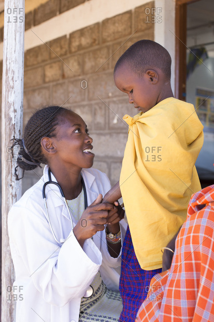 Doctor examining young child from the Maasai tribe, Kenya