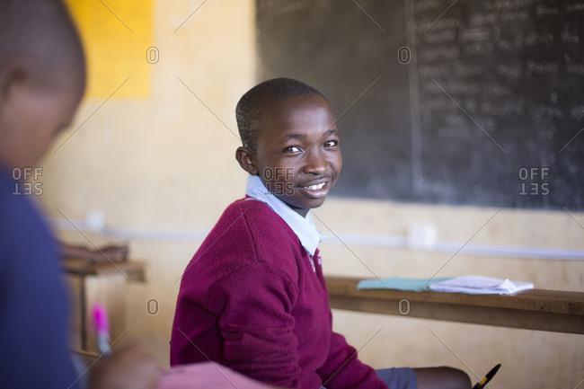 Portrait of smiling boy in classroom Kenya, Africa