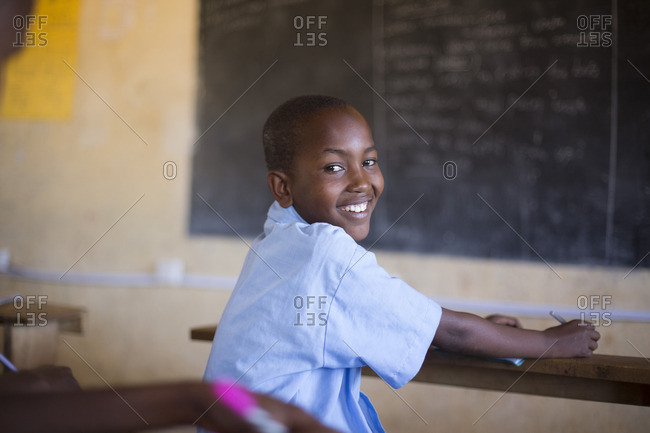 Smiling young boy in classroom, Kenya, Africa