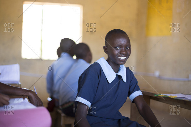 Portrait of girl in school uniform in classroom, Kenya