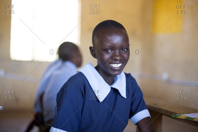 Portrait of smiling girl in classroom, Kenya, Africa
