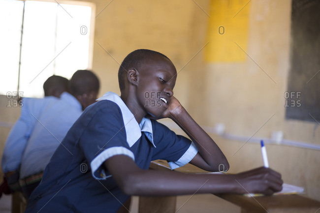 Girl studying in classroom, Kenya, Africa