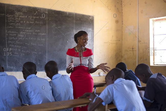 School teacher talking to her class in Kenya, Africa
