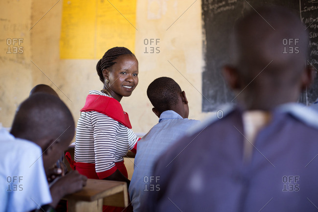Teacher working with her students in classroom, Kenya