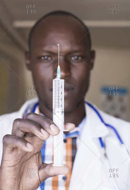 Doctor using with  syringe, Kenya, Africa