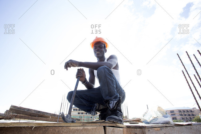 Portrait of African construction worker at building site, Kenya
