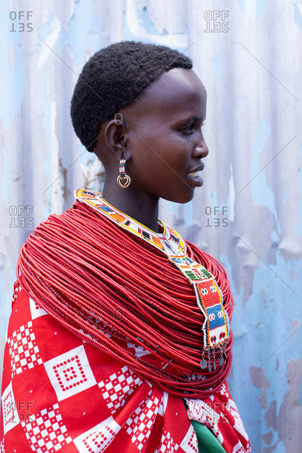 Side view portrait of Samburu woman with layers of red beaded necklaces