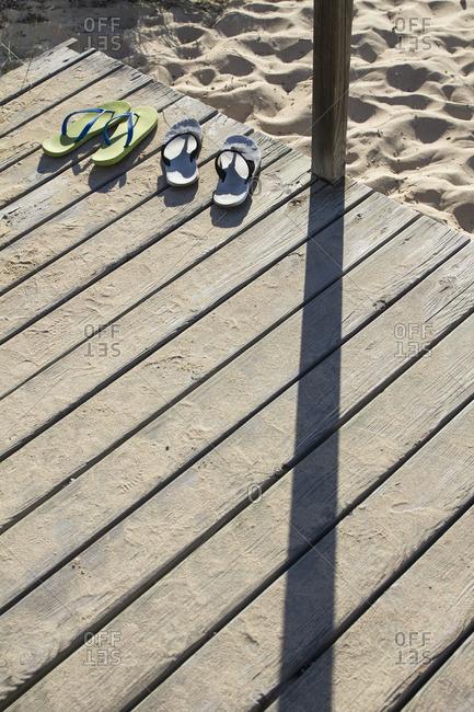 Flip flops on wood boardwalk, Mallorca, Spain