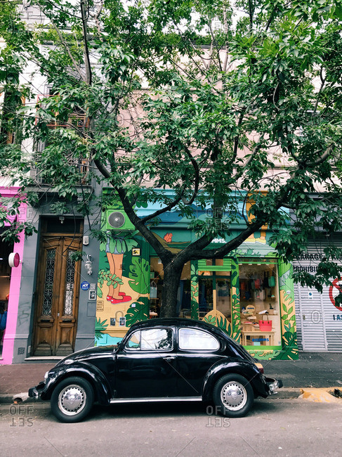 Buenos Aires, Argentina - January 13, 2017: Old car parked in front of Humms shoe store