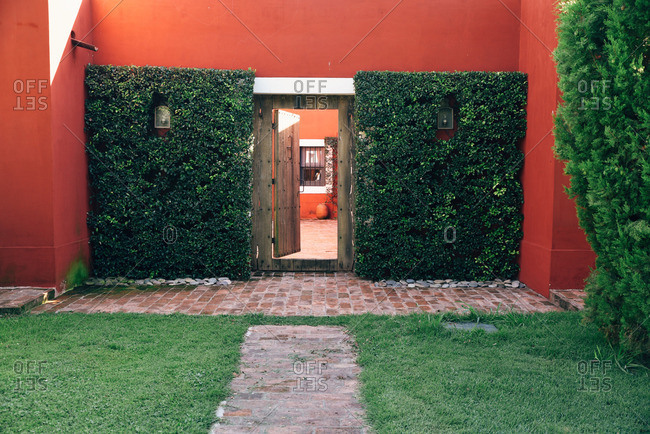 Entrance of a red ranch in Buenos Aires, Argentina