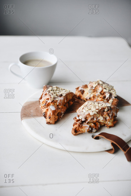 Coffee and scones on a white table
