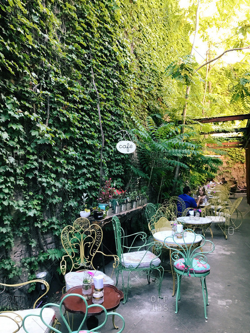 Buenos Aires, Argentina - January 12, 2017: Outdoor cafe by vine covered wall
