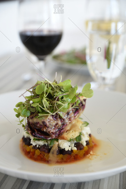 Dish topped with microgreens served in a restaurant