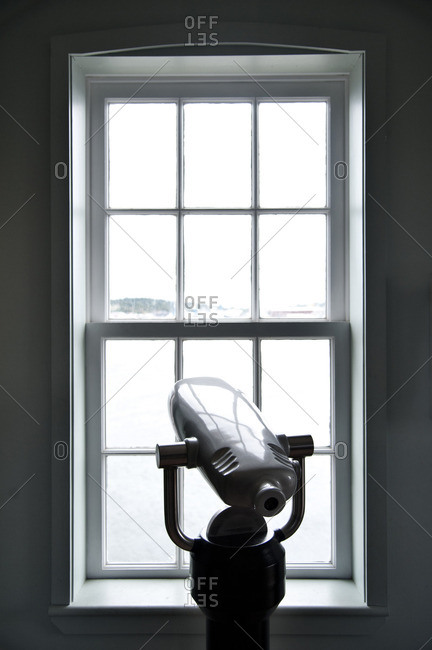 Telescope in front of a window