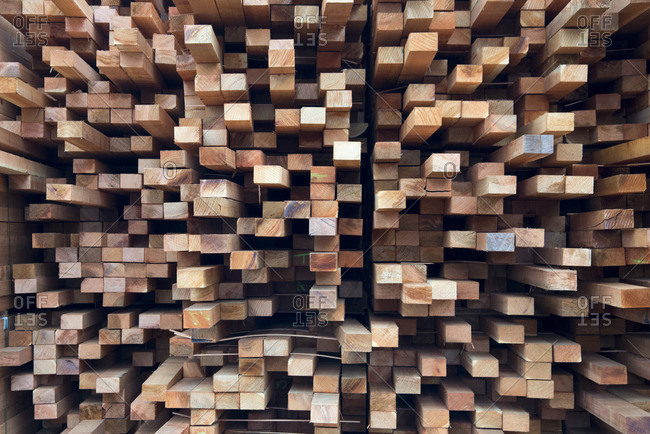 Stacked boards of lumber form a pattern