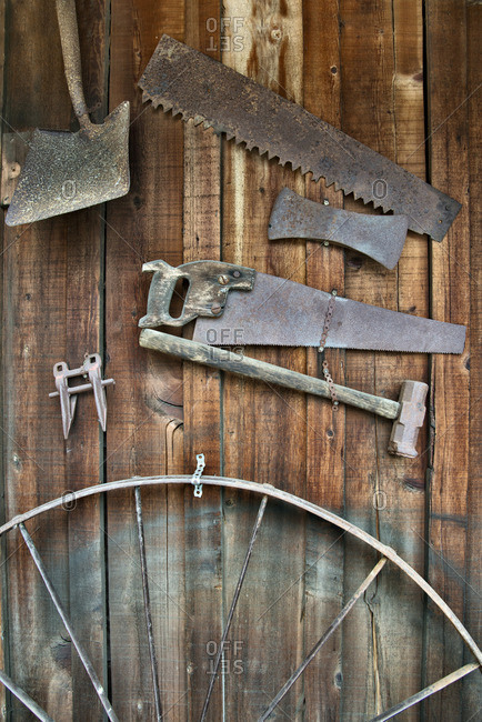 Antique farming implements on a barn wall