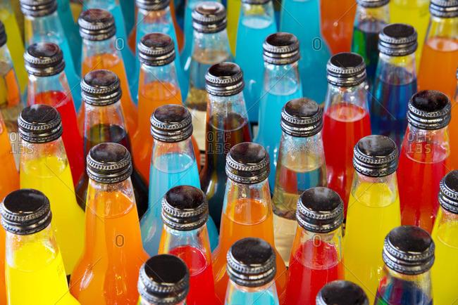 Bottle necks of colorful soft drinks