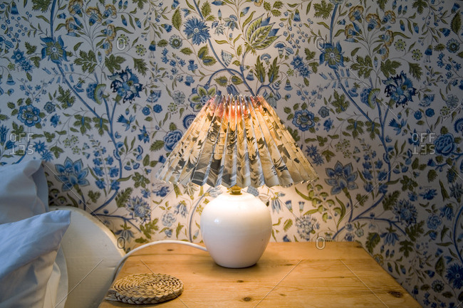 Lampshade and matching wallpaper on a bedside table