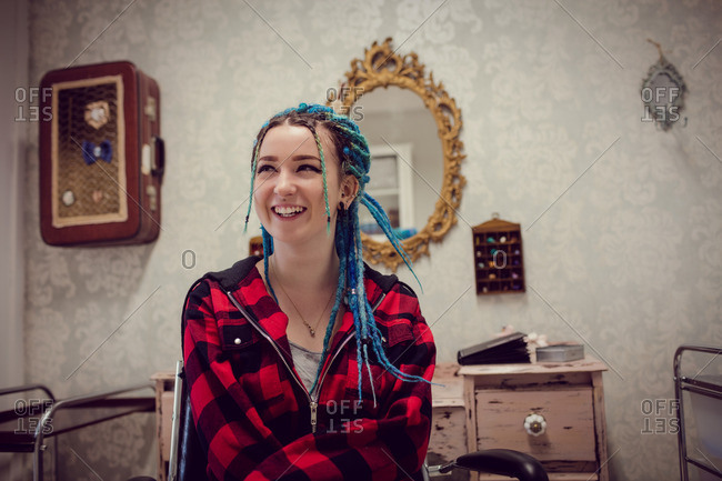 Woman with dreadlocks in salon