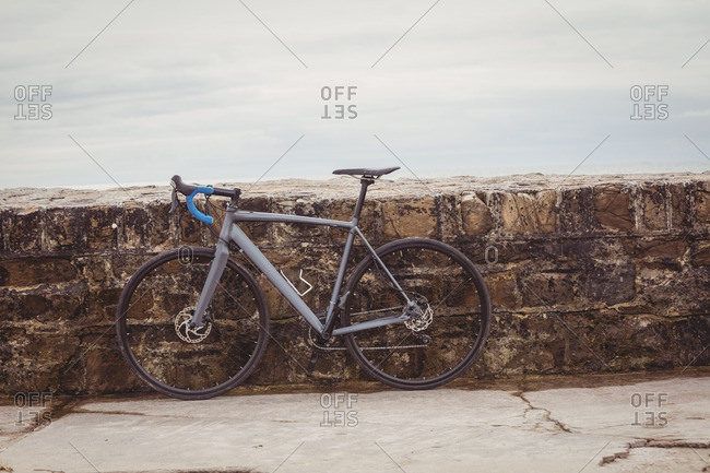 Bicycle parked against a wall