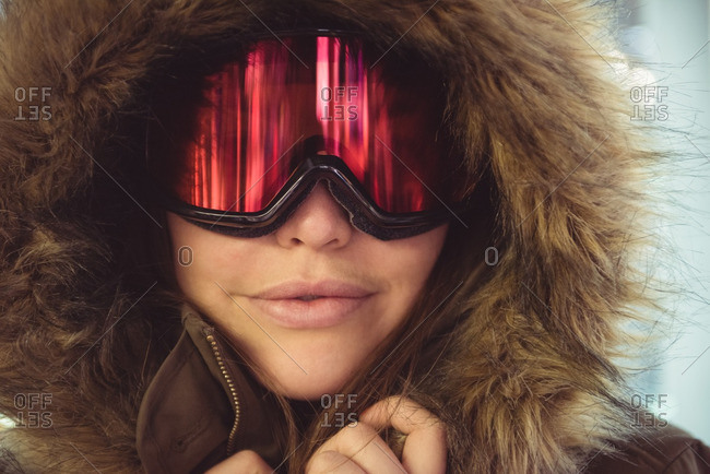Close-up of woman in fur coat and ski goggles