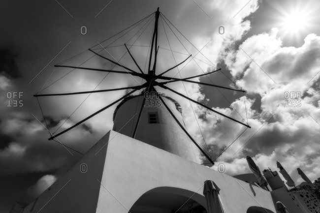 Windmill on top of Oia city in Santorini island.Black & white shot, Kiklades, Grecia, Greece