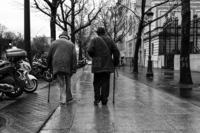 Two walking men in avenue de Friedland In Paris., Ile-de-France , France