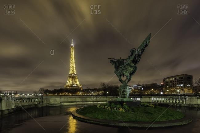 France,Francia, Ile-de-France, Paris.,  - March 29, 2015: Tour Eiffel and Jeanne D'arc statue .Paris, Ile-de-France , France