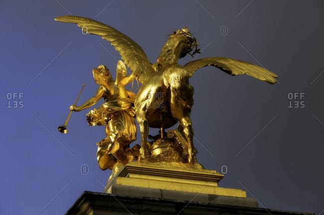 France,Francia, Ile-de-France, Paris,  - March 26, 2015: Golden horse statue at Alexander III Bridge. Paris, Ile-de-France , France