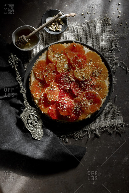 Gluten Free Tart decorated with citrus fruits
