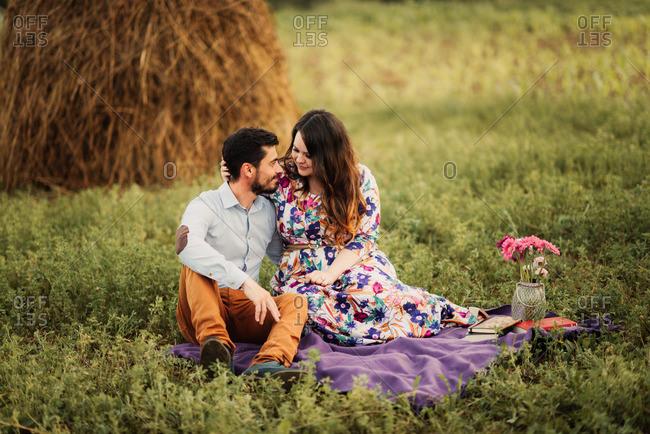 Couple on romantic meadow picnic
