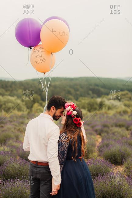 Loving bride and groom in lavender field