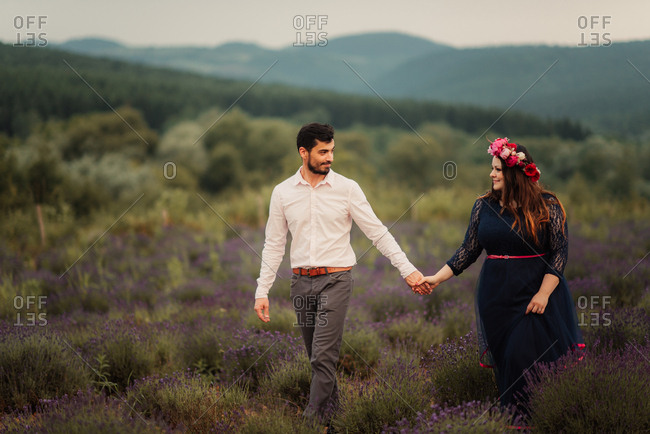 Bridal couple strolling in lavender