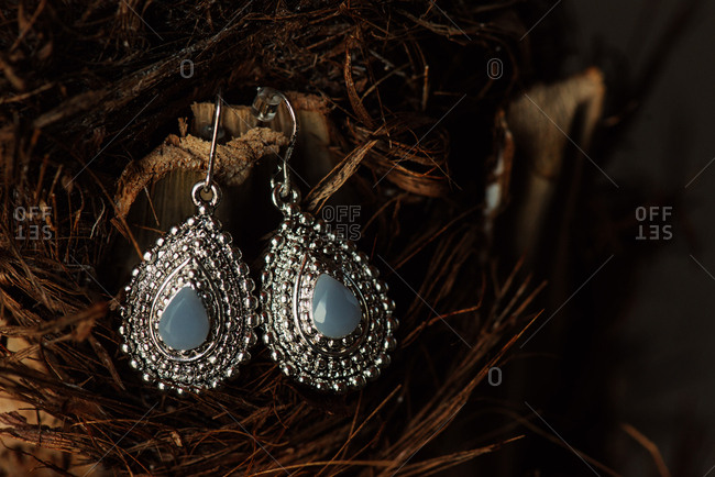 Silver teardrop earrings with stone setting