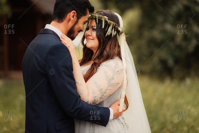 Bridal couple in a loving hug